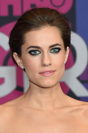 Allison Williams accentuated her eyes with heavy black liner and a tinge of metallic-green shadow.