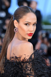 Joan Smalls attended the Cannes Film Festival screening of 'Girls of the Sun' wearing a sleek center-parted ponytail.
