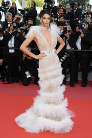 Kendall Jenner looked ethereal in a sheer white tulle gown by Schiaparelli Couture at the Cannes Film Festival screening of 'Girls of the Sun.'