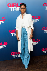 Underneath her coat, Jada Pinkett Smith wore a pair of baggy blue pants.