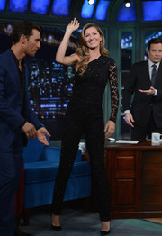 Gisele Bundchen looked every inch the glamorous supermodel in a beaded black one-shoulder jumpsuit by Emilio Pucci during her appearance on 'Jimmy Fallon.'