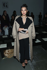 Arden Cho arrived for the Giulietta fashion show wearing a beige and black duster coat from the label's Resort 2016 collection.