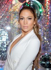 Jennifer Lopez complemented her 'do with a pair of diamond hoops by Le Vian.