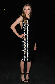 Amanda Seyfried opted for classic black strappy sandals at the Givenchy runway show in Paris.