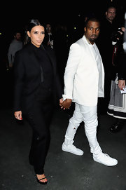 Kim Kardashian showed off her baby bump with this fitted pant suit while on a trip to Paris Fashion Week.