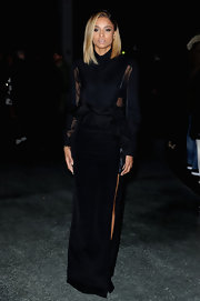 Ciara looked elegant but modern in a black ruffle dress with see through top.