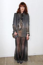 Florence wears a unique dove gray print blazer with her print-full ensemble.