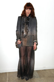 Florence wears a sheer maxi skirt with a matching blazer for the Givenchy fashion show.