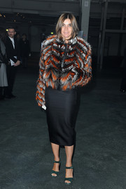 Carine Roitfeld looked vibrant and luxe in her colorful fur coat during the Givenchy fashion show.