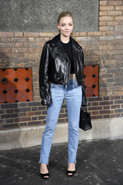 Amanda Seyfried arrived for the Givenchy menswear show rocking a black leather jacket from the brand.