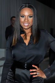 Jennifer Hudson wore vibrant orange nail polish at the Givenchy show in Paris. To recreate her look, try a product like OPI Nail Color in Hi Def.