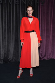 Karen Elson donned a loose, long-sleeve red blouse for the Givenchy Fall 2018 show.