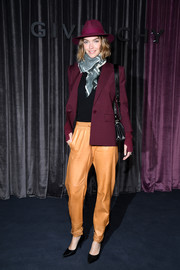 Arizona Muse topped off her outfit with a burgundy blazer, also by Givenchy.