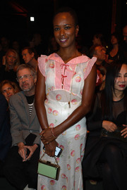 Shala Monroque attended the Givenchy fashion show carrying a chic mint-green and gold box clutch with a chain strap.