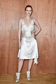 Karen Elson worked a seductive lace-trim LWD at the Givenchy fashion show.