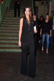 Christina Pitanguy donned a drapey, fringed black top for the Givenchy fashion show.