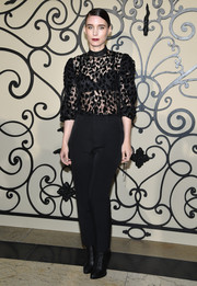Rooney Mara balanced out her sultry top with conservative trousers.