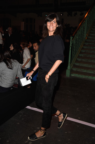 Emmanuelle Alt styled her sweatshirt with a pair of black suede pants.