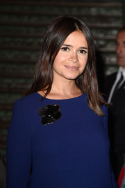 Miroslava Duma styled her plain blue outfit with a black flower brooch for the Givenchy fashion show.