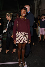Shala Monroque kept cozy with a red crewneck sweater during the Givenchy fashion show.