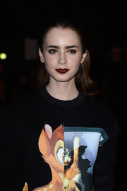 Lily Collins rocked a dark red lip at the Givenchy SS14 show.
