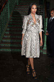 Ciara looked fierce in a cleavage-baring gray Givenchy snakeskin-print dress during the label's fashion show.
