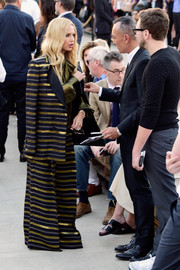 Rachel Zoe took her penchant for oversized dressing to extreme levels with this gold, black, and white striped pantsuit when she attended the Givenchy fashion show.