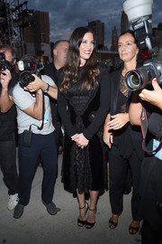 Liv Tyler went for goth elegance in a long-sleeve lace and velvet LBD during the Givenchy fashion show.