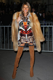 Anna dello Russo wore her fur coat with a vibrant sequined mini dress by Givenchy.