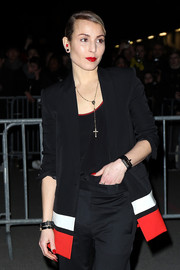 Noomi Rapace added a pop of color with bright red lips.