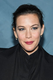 Liv Tyler sported a messy updo at the Givenchy Spring 2019 show.