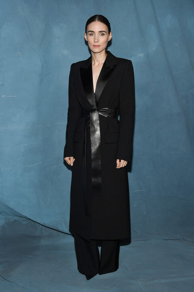 Rooney Mara looked sharp in a belted black coat and matching trousers at the Givenchy Spring 2019 show.