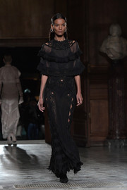 Liya Kebede was boho-sexy in a sheer black gown with a tiered bodice while walking the Givenchy runway.