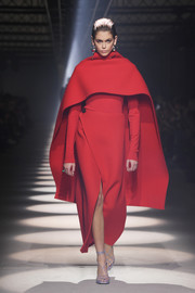 Kaia Gerber walked the Givenchy Fall 2020 runway wearing a red front-slit pencil skirt and a matching top.