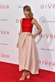 Taylor Swift exuded charm and sophistication in a two-tone tea-length dress by Monique Lhuillier during the NYC premiere of 'The Giver.'