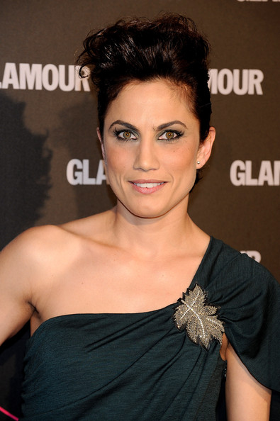 Toni Acosta pinned her brunette locks up in a pompadour, which worked nicely with her one-shoulder dress.