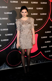 Miriam Giovanelli showed off the nude trend in a quarter-length sleeve dress which she paired with black tights.