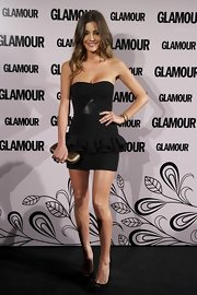 Malena Costa displayed her sun-kissed skin in a ruffled little black dress at the Glamour Beauty Awards 2012.