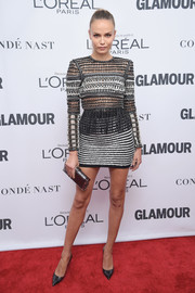Natasha Poly teamed her top with a metallic striped mini skirt, also by Balmain.