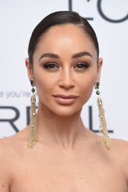 Cara Santana styled her hair into a side-parted updo for the 2017 Glamour Wpmen of the Year Awards.