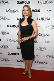 Jodie Foster glammed up her LBD with gold strappy sandals.