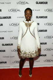 Lupita Nyong'o looked regal in an elaborately beaded Chanel Couture dress, with matching embellished cycling shorts peeking from the hem, during the Glamour Women of the Year Awards.