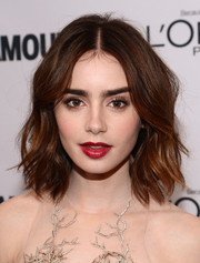 Lily Collins wore cherry shade lipstick to Glamour's 23rd annual Women of the Year Awards.