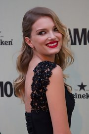 Lily Donaldson accentuated her lips with a vintage red hue.