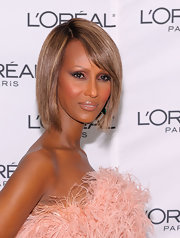 At the 'Glamour' magazine women of the year honors, Iman kept her makeup look simple with a shimmering amethyst eye shadow, soft black liner and mascara.
