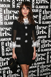 Alexa Chung charmed in a black cocktail dress with white flower appliques during Glamour's presentation of 'These Girls.'