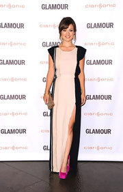 Olivia Wilde added a chic pop of color to her neutral ensemble with fuschia pink platform pumps.