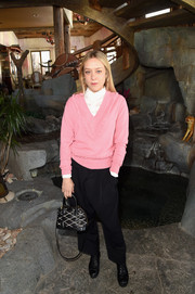 Chloe Sevigny bundled up in a pink V-neck sweater layered over a white button-down shirt for Glamour's Women Rewriting Hollywood lunch.