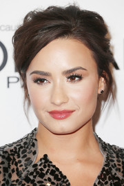 Demi Lovato went for simple styling with a pair of black diamond studs by Harry Kotlar.