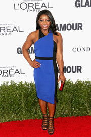 Simone Biles looked sophisticated in a two-tone halter dress at the Glamour Women of the Year 2016.